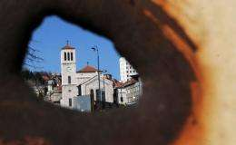 """A view of the main square """"Marijin Dvor"""" in the Bosnian capital Sarajevo, is seen through a 20 year old shrapnel hole"""