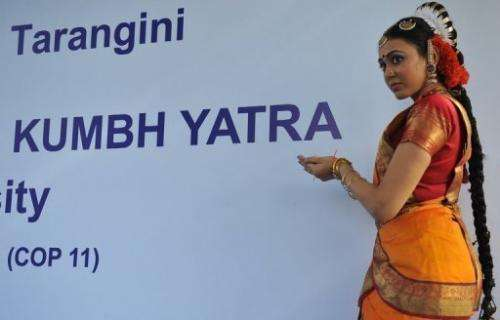 A woman performs a traditional dance during the ceremonial launch of the world's first 'Green Kumbh Yatra' in Hyderabad