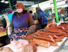A woman wears a mask on a market in the western Ukrainian city of Lviv in 2009