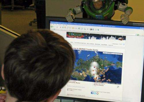 A young boy looks at the NORAD website to check on the progress of Santa Claus on December 24, 2009