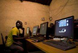 A young man sits at a cyber cafe in Kenya in June