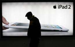 Bankruptcy threat to iPad trademark challenger (AP)
