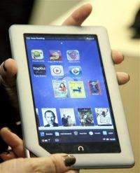 Barnes & Noble falls on guidance cut, Nook review (AP)