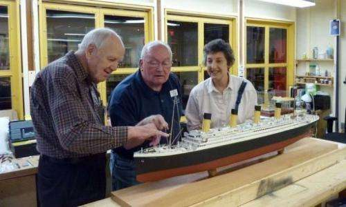 Biologist Henrietta Mannon watches as volunteers finish a model of the RMS Titanic