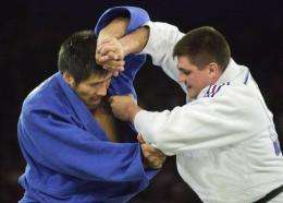 David Douillet of France fights against Shinichi Shinohara of Japan in his gold medal victory