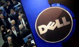 Dell said its net income fell 18 percent from a year ago to $732 million