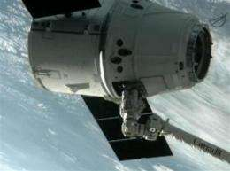 Dragon makes history with space station docking (AP)