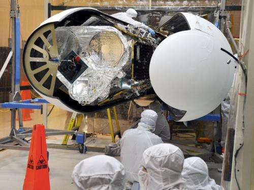 Engineers tuck nuSTAR in its nose cone