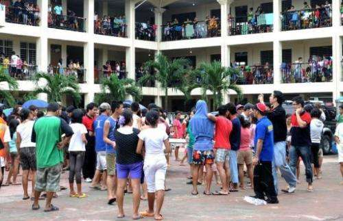 Flood victims take shelter in a school serving as an evacuation centre