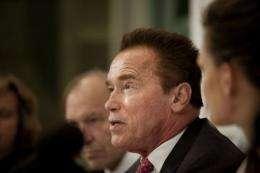 Former Govenor of California and actor Arnold Schwarzenegger (R)