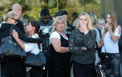 Friends and family of Kim Dotcom stand outside the North Shore court in Auckland