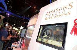 """Gamers play Ubisoft's video game """"Assassin's Creed"""" in 2011"""
