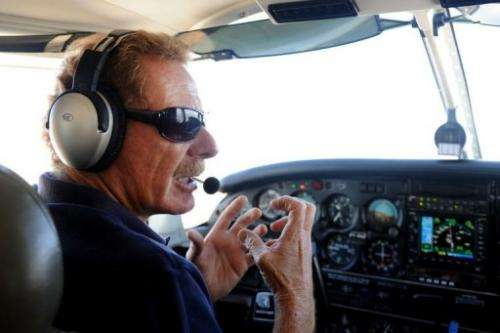 "Gerard Moss talks as he flies the small plane he uses for his ""Rios Voadores"" (Flying Rivers) project"