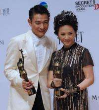 "Hong Kong actors Deanie Ip (R) and Andy Lau on after winning awards for their roles in the film ""A Simple Life"""
