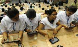 "Indian students use ""Aakash"" in New Delhi in October"