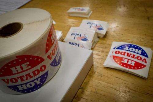 """I voted"" stickers in Spanish and English are seen at a polling station"