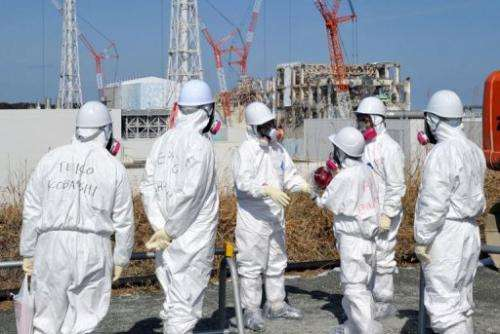 Journalists in protective clothing visit the stricken Fukushima nuclear power plant this week