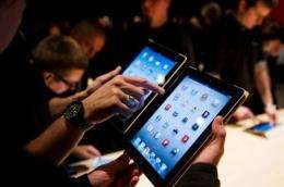 Journalists test the new iPad following a live stream of its US launch, at an event in central London on March 7