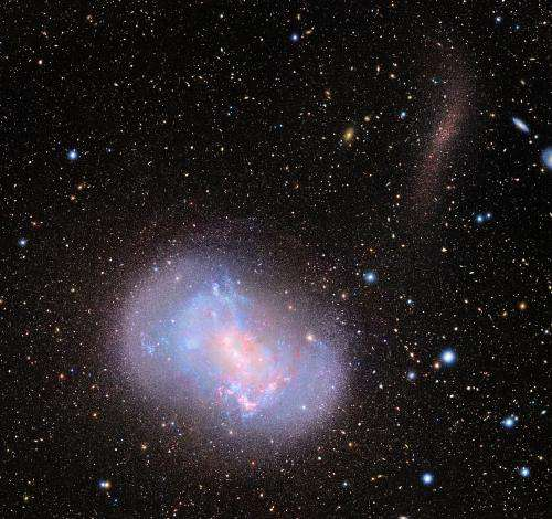 New images capture 'stealth merger' of dwarf galaxies