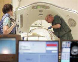 Lung cancer CT scans: Just for older heavy smokers (AP)