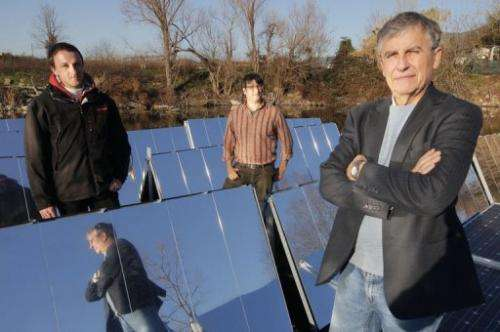 Marco Rosa-Clot (R) and his team of engineers have built a cost-effective prototype for floating, rotating solar panels