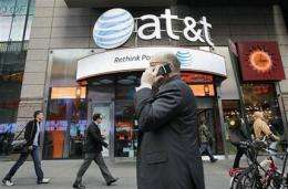 Monthly smartphone bills down at AT&T (AP)