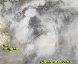 NASA sees organizing tropical low pressure area near the Philippines