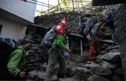 Nepalese mountaineer Apa Sherpa (C) is expected to complete his 120-day 'Climate Smart Celebrity Trek' on May 13