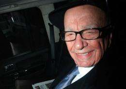News Corporation chief executive Rupert Murdoch leaves his London home