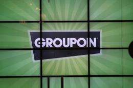 Online US daily deals firm Groupon said Monday it had acquired the restaurant reservation company Savored