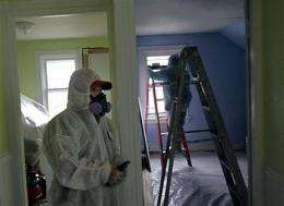 Panel urges lower cutoff for child lead poisoning (AP)