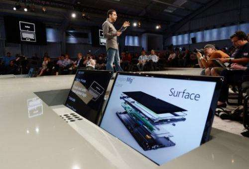 Panos Panay, General Manger of Surface, holds the tablet Surface