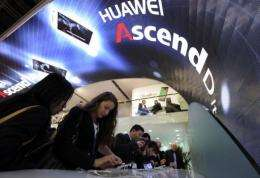 People check the Huawei Ascend P1S smartphone