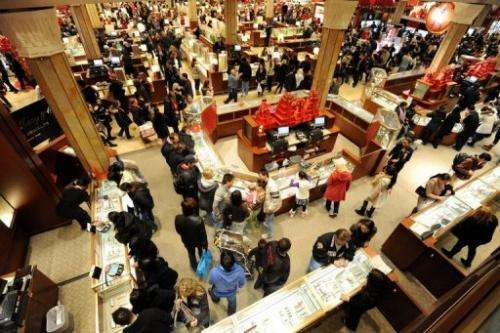 "People crowd the aisles inside a Macy's department store after the midnight opening on ""Black Friday"" in 2011"