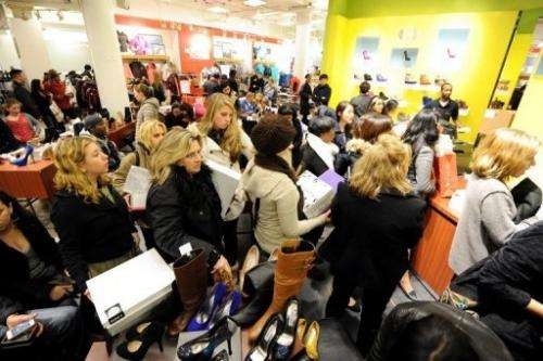 People stand in line to make purchases inside Macy's department store on Black Friday in 2011