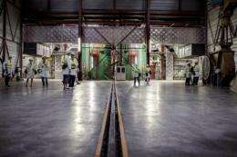 People walk in a corridor of the Eurodif SA/George Besse 1 uranium enrichment plant in Saint-Paul-Trois-Chateaux, France