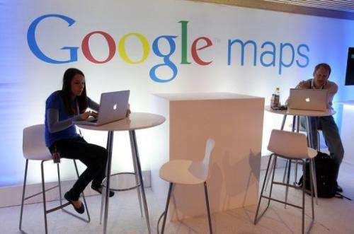 People work on laptops at a news conference about Google Maps in San Francisco on June 6, 2012.