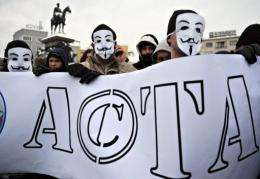 Protestors hold a banner during a protest against the Anti-Counterfeiting Trade Agreement (ACTA) in Bulgaria
