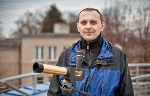 Rafal Laskowski,  a teacher in a school of Jablonowo, standing on the terrace of the village's Astrobase