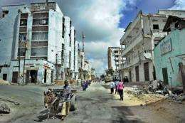 Residents walk through the Bakara market area of Somalia's embattled capital Mogadishu, in 2011