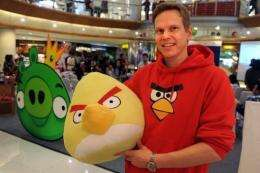 """Rovio Asia senior vice president Henri Holm with an """"Angry Birds"""" doll at an official Facebook launch in Jakarta"""