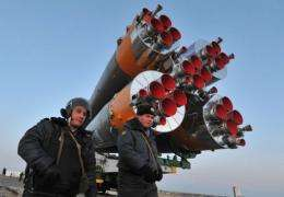 Russian police officers guard  the Soyuz TMA-22 rocket