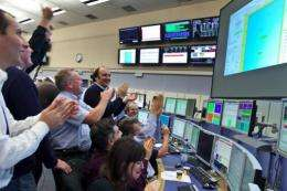 Scientists celebrating at the CERN's control center after the restart operation of the Large Hadron Collider in 2009