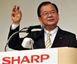 Sharp's newly appointed president Takashi Okuda announces the company's tie-up with Taiwan's Hon Hai Precision