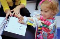 Movement-limited toddler gets 3-D-printed magic arms    (w/ Video)