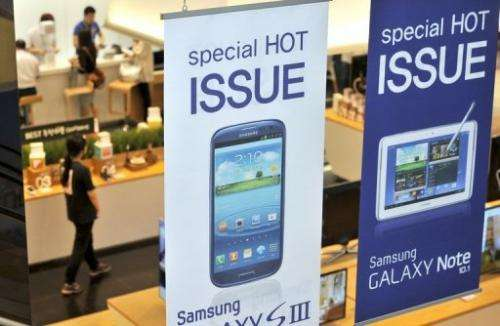 Signboards of Samsung Electronics' Galaxy S3 and Galaxy Note 10.1, pictured at a showroom in Seoul, on August 24, 2012