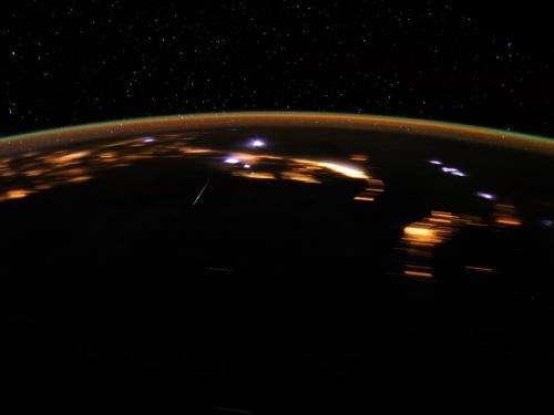 Stunning lyrid meteor over earth at night
