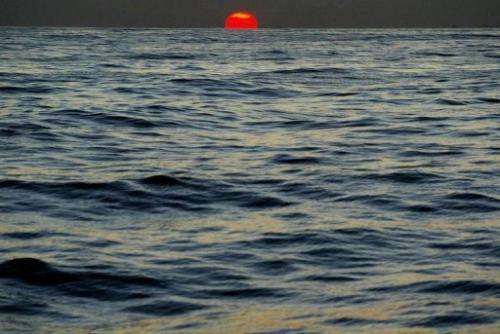 Sunset is seen from on board a fishing boat