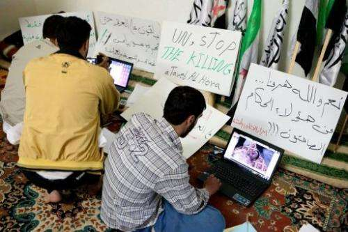 Syrian activists use the internet in a town west of Aleppo
