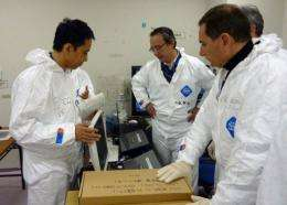 Takeshi Takahashi (L), chief of the stricken Fukushima Daiichi nuclear power plant, shows data to Eric Besson
